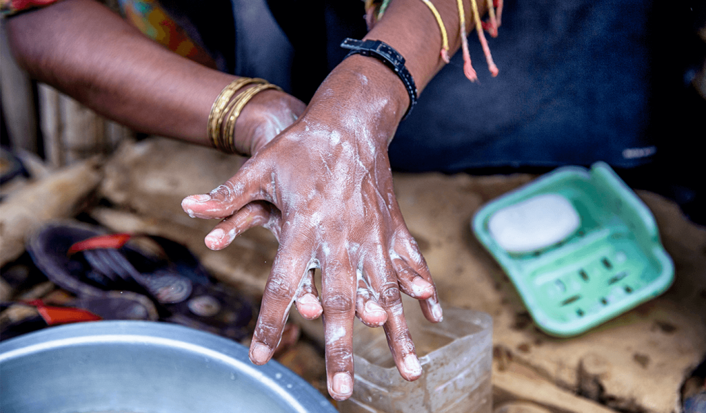 Woman washing hands.